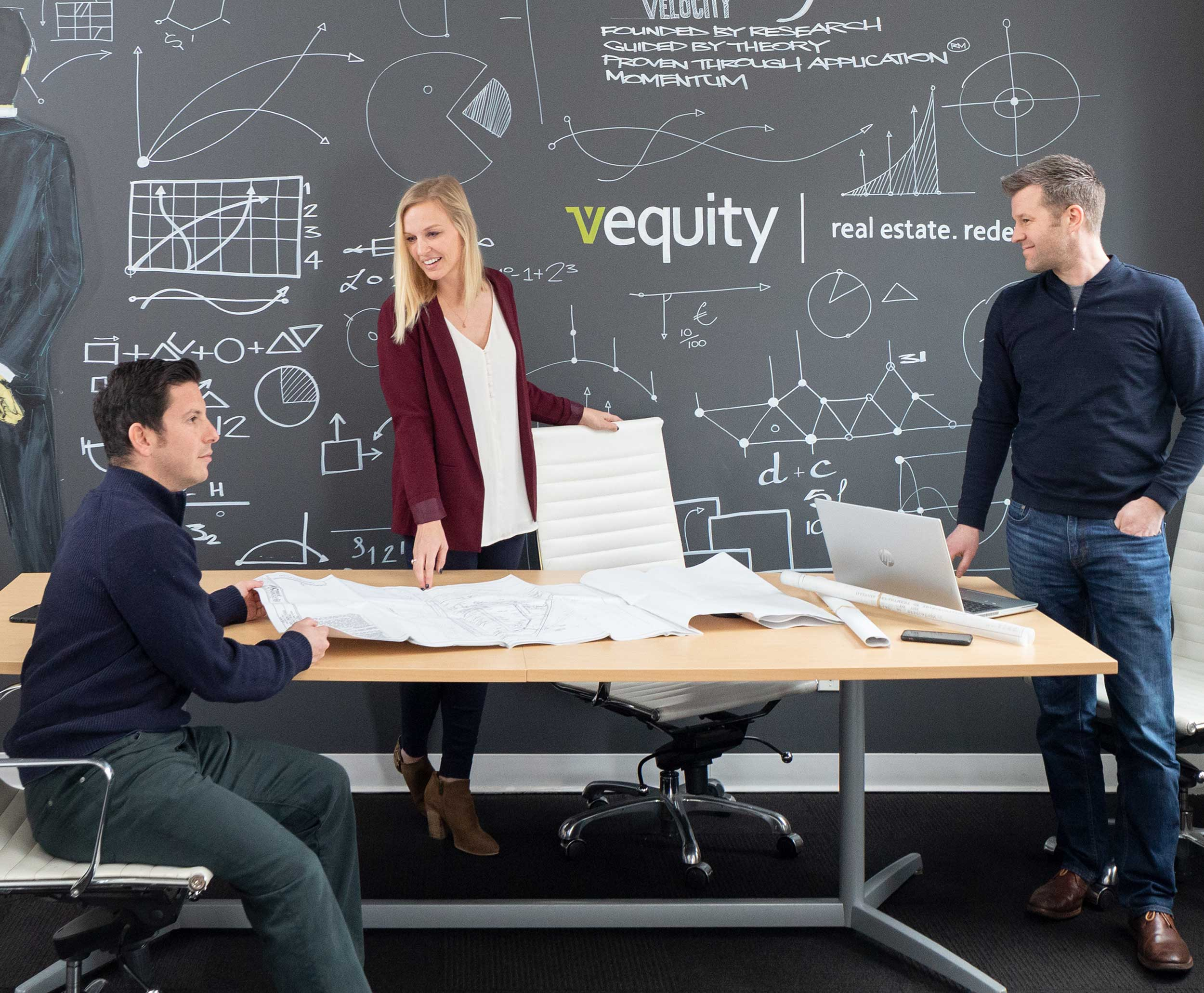 Employee discussion at Vequity corporate headquarters