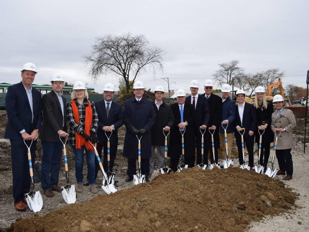 Group of people with shovels at the groundbreaking in Downers Grove
